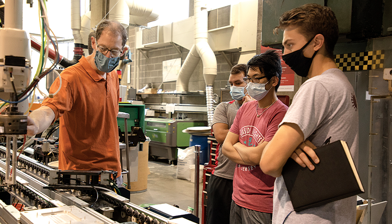 Professor gives students a tour of manufacturing systems.