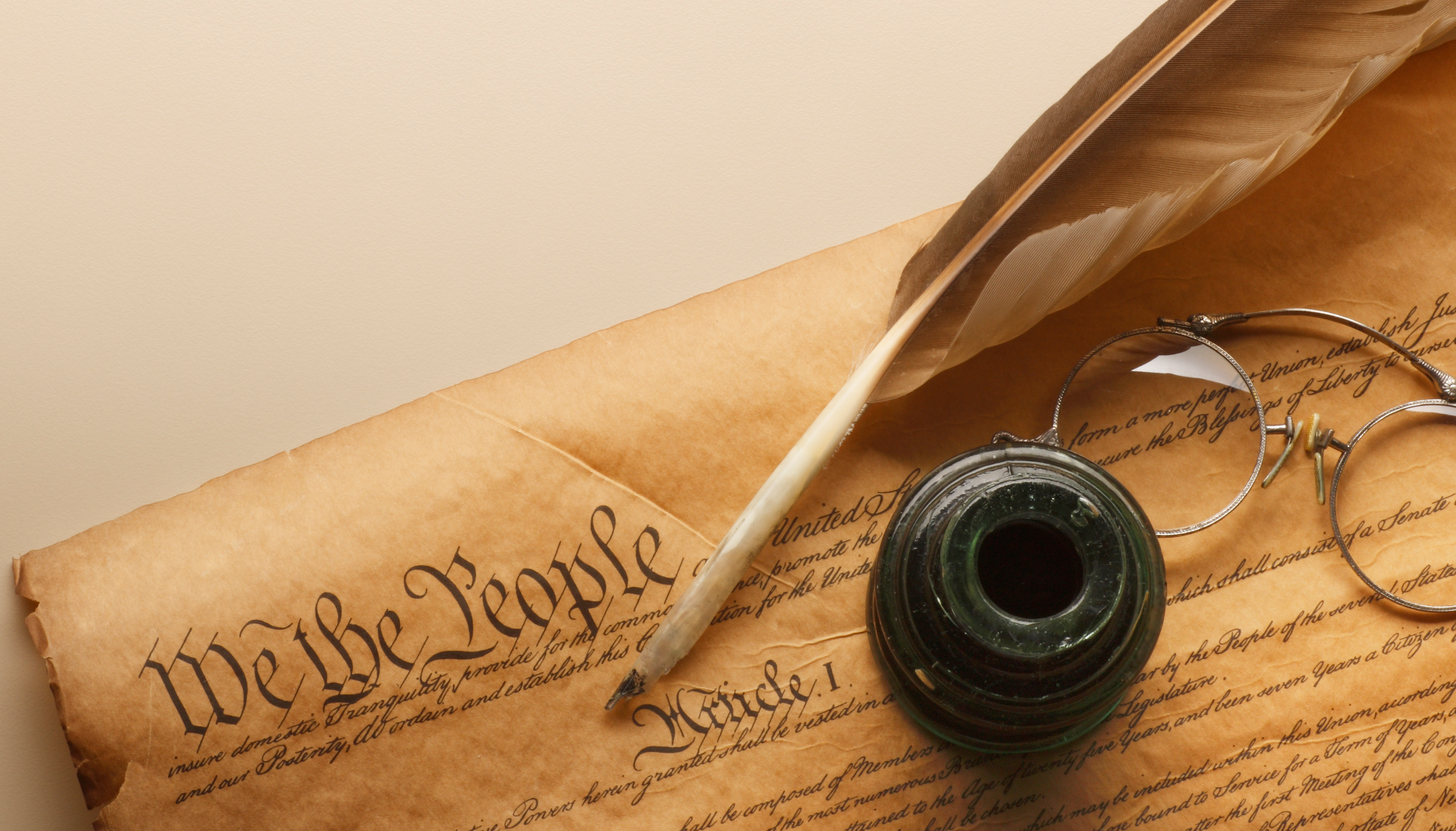 Constitution with a quill and inkwell